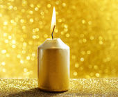 Golden candles. Gold glittering christmas lights. Blurred abstra — 图库照片