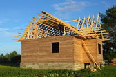 Wooden house under construction — Stock Photo