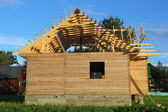Wooden house under construction — 图库照片