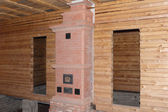 New brick oven in the timber house under construction — Stock Photo