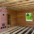 Timber house interior with oven and  floor balks under construction — Stock Photo