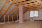 Attic with chimney in wooden house under construction — Stock Photo