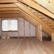 Stock Photo: Attic in wooden house under construction overall view