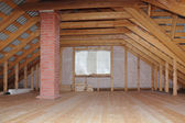 Attic with chimney in wooden house under construction overall view — Stock Photo