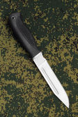 Military knife lying diagonally on camouflage background — Stock Photo