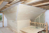 Attic under construction: mounting mineral cotton and deal board — Stock Photo