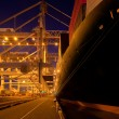 Loading and unloading at a container terminal - Stock Photo