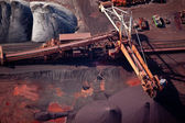 Conveyor belt carrying coal and emptying onto a huge pile — Stock Photo