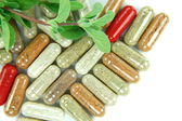 Closeup of herbal capsules — Stock Photo