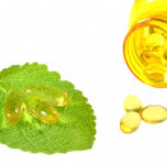 Fish oil capsules on sage leaf — Stock Photo #25850239
