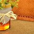 Jar of fresh and delicious honey with linden flowers and honeycomb — Stock Photo
