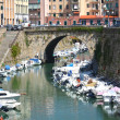 Picturesque view on boats in city channel in Livorno, Italy — Stock Photo
