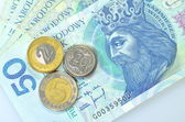 Zloty banknotes and coins from poland — Stockfoto
