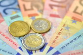 Variety of euro banknotes and coins — Stock Photo
