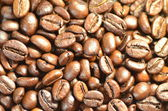 Roasted coffee beans for background — Stock Photo
