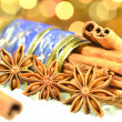 Christmas season, cinnamon sticks, anise stars on bokeh background — Stock Photo