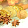 Christmas spices, cinnamon sticks, anise stars and walnut on bokeh background — Stock Photo