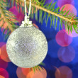 Christmas decoration, Christmas ball hanging on spruce twig against bokeh background — Foto de Stock