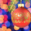 Christmas decoration, Christmas ball hanging on spruce twig against bokeh background — Zdjęcie stockowe