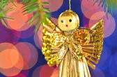 Christmas decoration, angel made of straw and bokeh background — Stock Photo