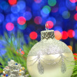 Christmas decoration, silver Christmas ball against bokeh background — Stock Photo
