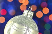 Christmas decoration, silver Christmas ball against bokeh background — Photo