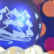 Christmas decoration, blue Christmas ball against bokeh background — Stock Photo