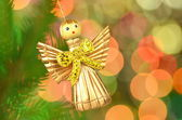 Christmas decoration, golden angel made of straw against bokeh background — Photo