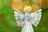 Christmas decoration, silver angel made of straw and bokeh background — Stock Photo