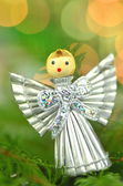 Christmas decoration, silver angel made of straw and bokeh background — Stok fotoğraf