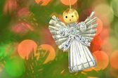 Christmas decoration, silver angel made of straw and bokeh background — Foto Stock