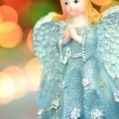 Christmas decoration, figure of blue angel against bokeh background — Stock Photo
