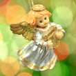 Christmas decoration, figure of little angel playing the harp against bokeh background — Stock Photo #36916583