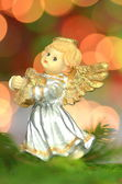 Christmas decoration, figure of little angel playing the harp against bokeh background — Stock Photo