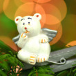 Christmas decoration, white bear angel on clip against bokeh background — ストック写真