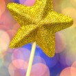 Christmas decoration, golden brocade star against bokeh background — Stock Photo