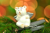 Christmas decoration, white bear angel on clip against bokeh background — Stock Photo