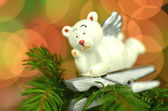 Christmas decoration, white bear angel on clip against bokeh background — Stok fotoğraf
