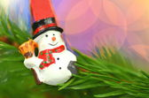 Christmas decoration, snowman on clip against bokeh background — Stock Photo