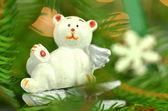 Christmas decoration, white bear angel on clip against bokeh background — Stock Photo