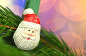 Christmas decoration, santa claus on clip against bokeh background — Stock Photo