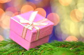 Christmas decoration, pink Christmas present against bokeh background — Stok fotoğraf