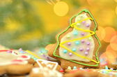 Delicious decorated Christmas cookies on bokeh background — Foto de Stock