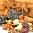 Christmas spices, nuts and dried fruits isolated on white background — Stock Photo
