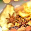 Christmas spices, nuts and dried fruits on bokeh background — Stock Photo