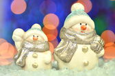 Christmas decoration, two figures of snowman against bokeh background — Foto Stock