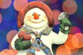 Christmas decoration, figure of snowman against bokeh background — Stock Photo