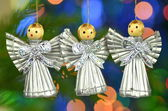 Christmas decoration, choir of angels against bokeh background — Stockfoto