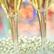 Two glasses of champagne against bokeh background — Stock Photo #37555943