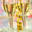 Two glasses of champagne against bokeh background — Stock Photo #37555949